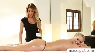 Sexy masseuse gives client a massage and lesbian pleasures