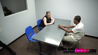 A lucky black dude fucks two cock hungry female cops in the interrogation room