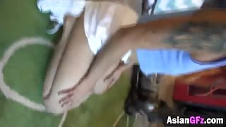 Tattooed Asian gf doggy style long dong shaved