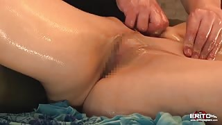 Gorgeous Japanese MILF oiled and fucked on a sensual massage