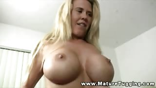 Hot blonde mature wanking young dudes cock in bedroom