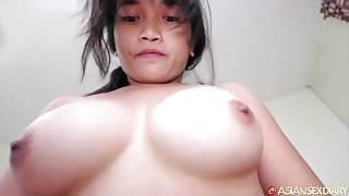 Young Asian girl with big firm tits