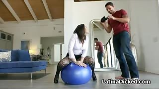 Assy gf in pantyhose blows on fitness ball