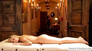 Lesbian masseuse licking Carmens pussy on massage table