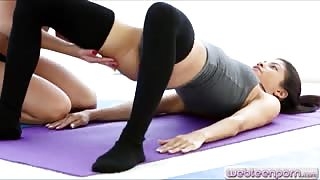 Yoga babes fondling each others pussies on a mattress