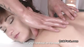 Oiled sexy babe fucked by masseur in massage room