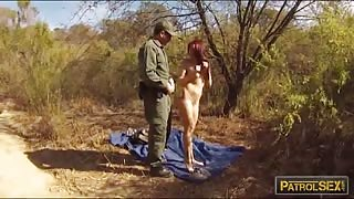 Redhead babe gets her pussy stuffed by border patrol officer