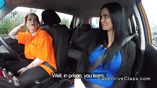 Busty examiner licks huge tits driving student