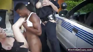 Naughty cops enjoy sucking black cock in dirty threesome outdoor play