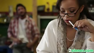 Ebony chick riding long rod like cowgirl on table
