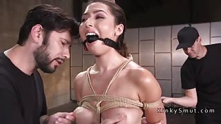 Brunette in bondage deep throated