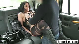 Busty escort fucks taxi driver in the backseat for free