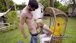 Petite blonde gives blowjob in backyard
