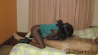 Busty African teen riding white cock in hotel room