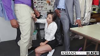 A naughty Asian tailor gets double penetrated by horny dark men