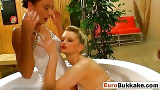 Naughty European babes get golden shower from studs