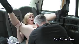 Busty blonde gives tit wank in fake taxi