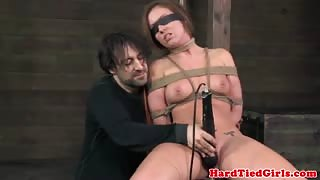 Blindfolded submissive has pussy toyed
