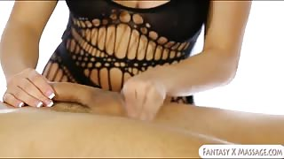 Busty masseuse sucks and cum facialed under the table