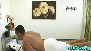 Nasty Asian girl oils and rubs a guy's body and rides his cock