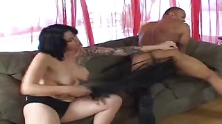 Tattooed brunette goes for the dick