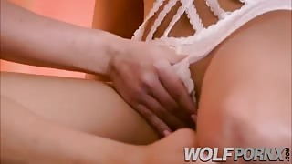 Two beautiful lesbians touch each others pussy