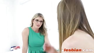 MILF stepmom with glasses caught her stepdaughter masturbating and she joins her