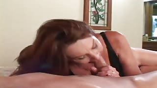 Mature brunette stuffs cock in mouth & vag