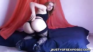 Naughty Bombshell Wearing Hosiery Strip-Teases In Front Of Camera