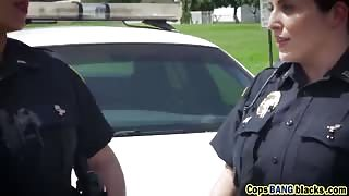 Busty cop bitches share a big black dick in the middle of the street