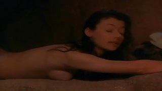 Mia Sara strips nude and gets into a pool of water