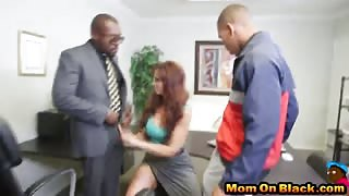 Redhead milf secretary can't pick one so she choose two BBC for threesome