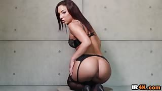 Sultry pole dancer brunette exposing big butt wearing sexy lingerie