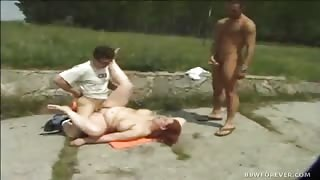 Large Redhead Sexpot Services Two Needy Dicks