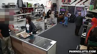 Busty mature babe sucking cock at the pawn shop