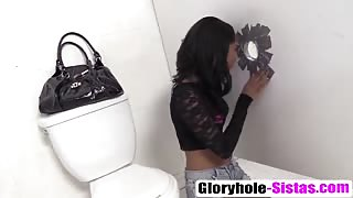 Ebony Cali Sweets visits gloryhole and starts sucking hard dick while fingering pussy