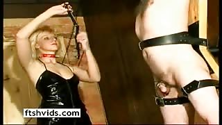 Blonde dominatrix in latex have fun playing with her slave