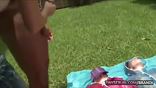 Hot babe wanks hard cock while 3 girls laying on the grass