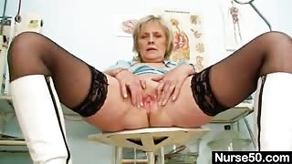 Kinky Head Nurse Does Self-Test Using Spreader Tool