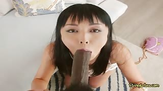 Asian Chick Marica Hase Munches On Chocolate