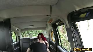 Redhead babe flashes tits inside the cab