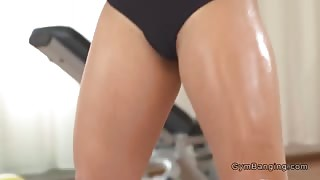 Fit lesbians weight lifting in the gym